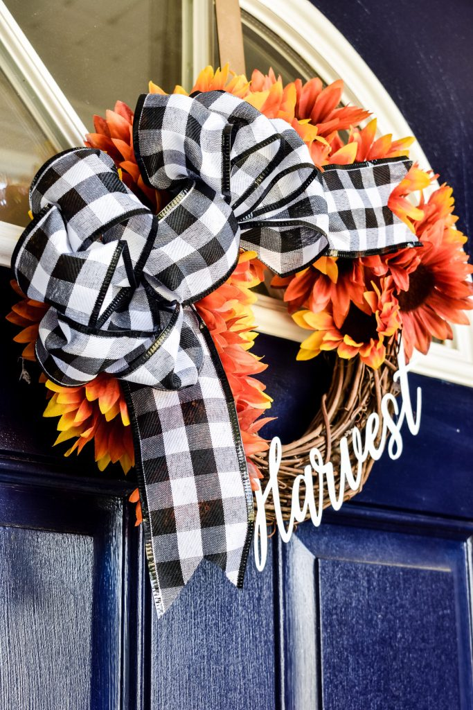 fall grapevine sunflower wreath with black and white buffalo check bow