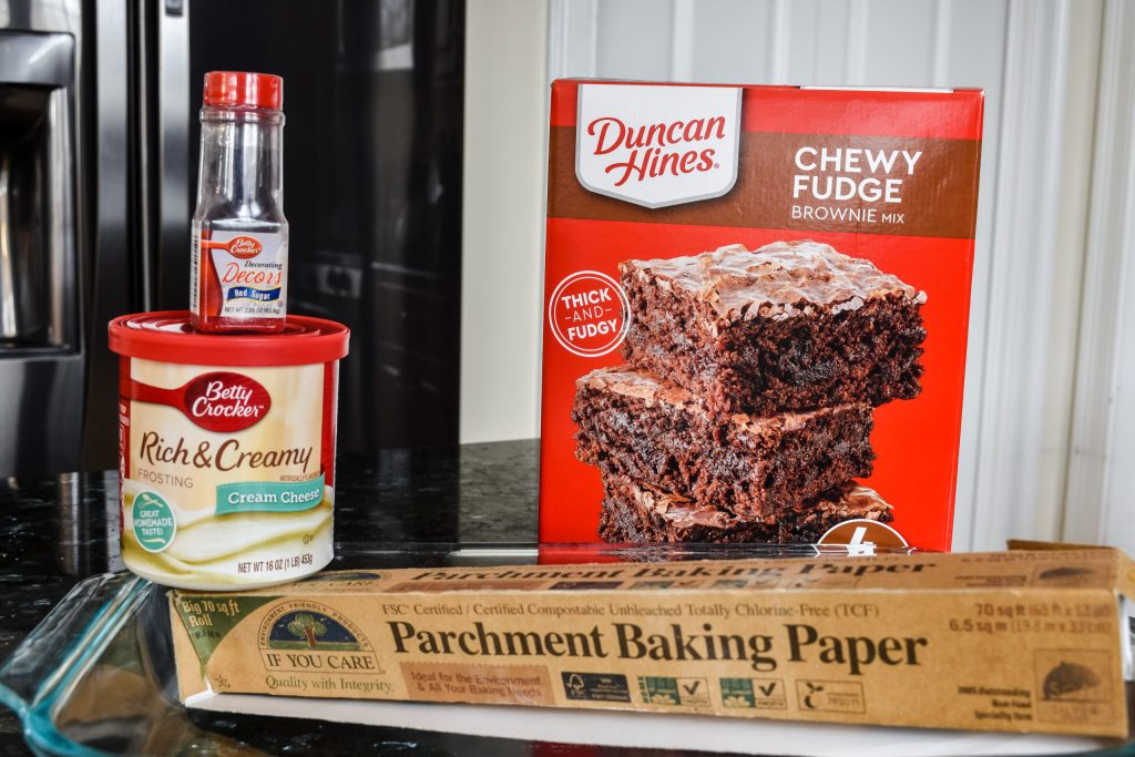 ingredients to make brownies with frosting and sprinkles
