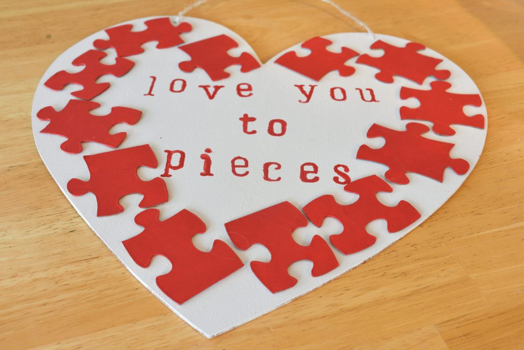 """""""love you to pieces"""" puzzle piece heart shaped wall hanger"""