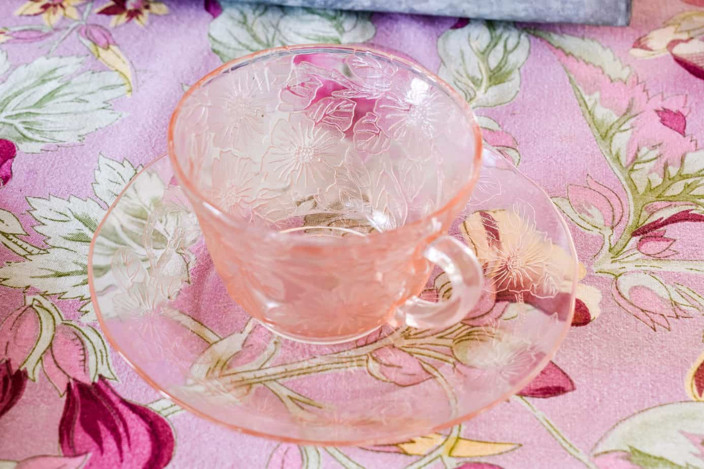 pink dogwood depression glass cup and saucer