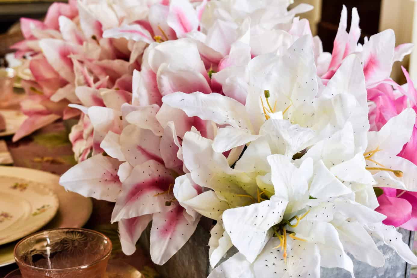 pink and white faux lilies from Dollar Tree on a pink Easter tablescape