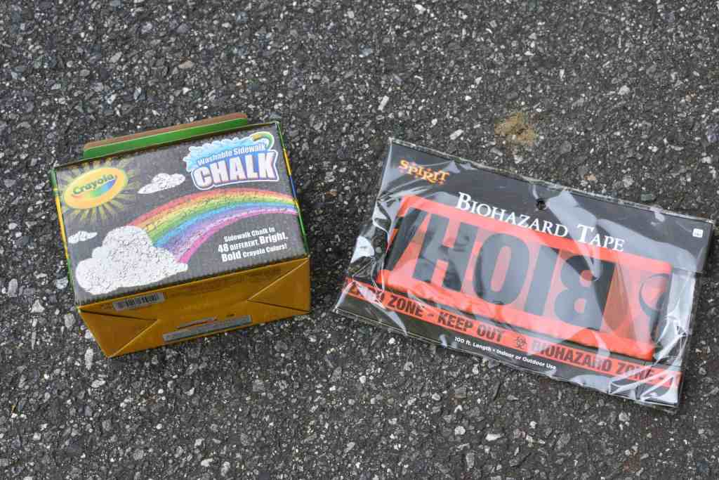 a box of colored chalk and a package of biohazard tape