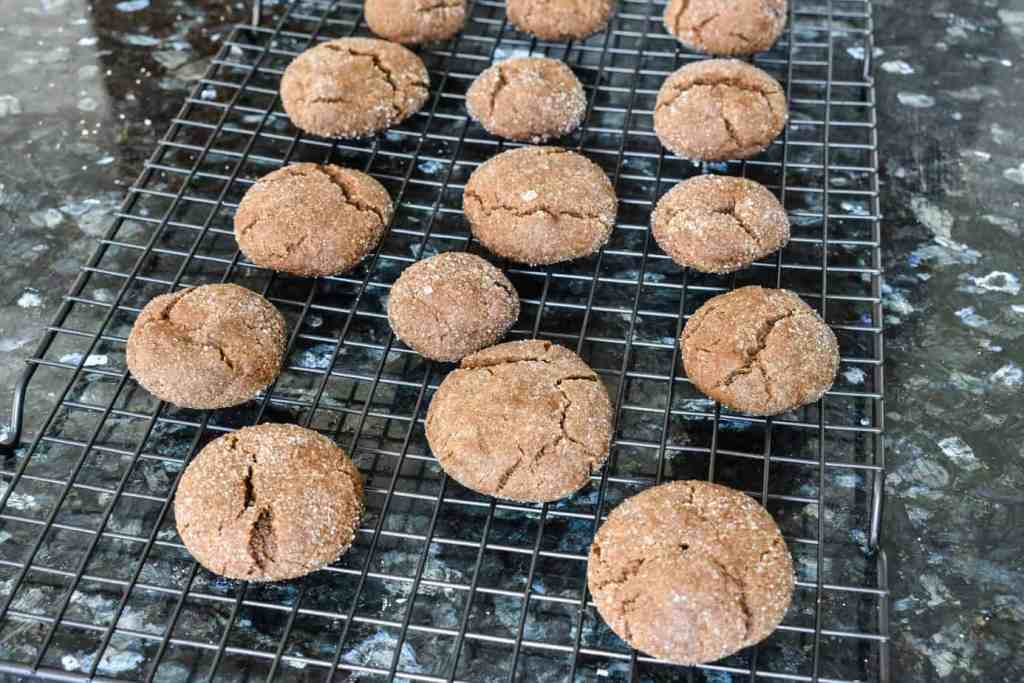 old fashioned ginger snaps cooling on a metal rack