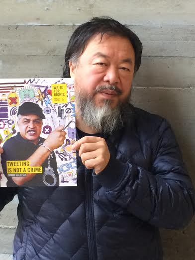 Chinese artist and activist, AI Wei Wei holds up the artwork produced by Amnesty International to highlight one the 2015 Write for Rights cases, Zunar. Zunar is a cartoonist from Malaysia and one of Amnesty's Individuals at Risk cases. Ai Weiwei supports the campaign. Taken by AI's Senior Director Thomas Schultz-Jagow in Berlin, Germany