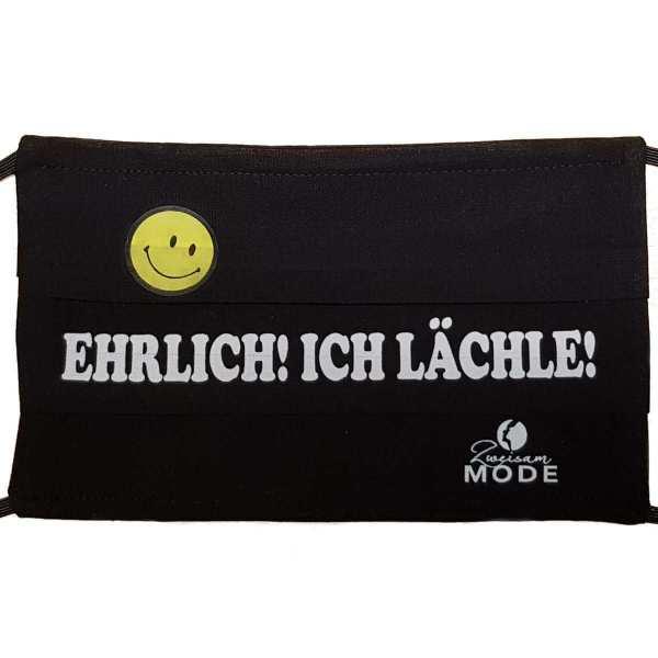 """Gesichtsmaske wiederverwendbar bequem  mit Hunor / Spruch """"Ehrlich ich Lächle"""" schwarz mit weisser Schrift von Zweisam Mode schonach im Schwarzwald"""