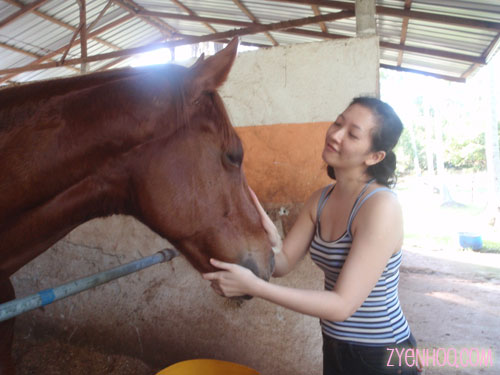 Me babytalking to a horse while waiting for our turn to go on the trail ride