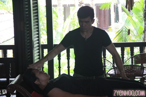James' demonstrating energy healing on a volunteer