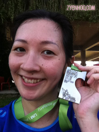 Selfie with the finisher medal. This is supposed to be combined with a medal from NEXT year's run.