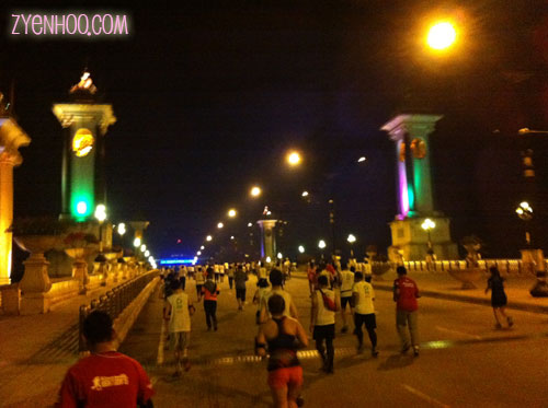 Running across one of the many bridges in Putrajaya