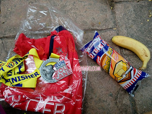 Finisher items for half-marathon runners, including a T-shirt, medal, bun and banana