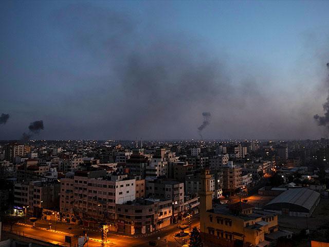Black smoke rise following Israeli airstrikes on Gaza City, Wednesday, May 12, 2021. (AP Photo/Khalil Hamra)