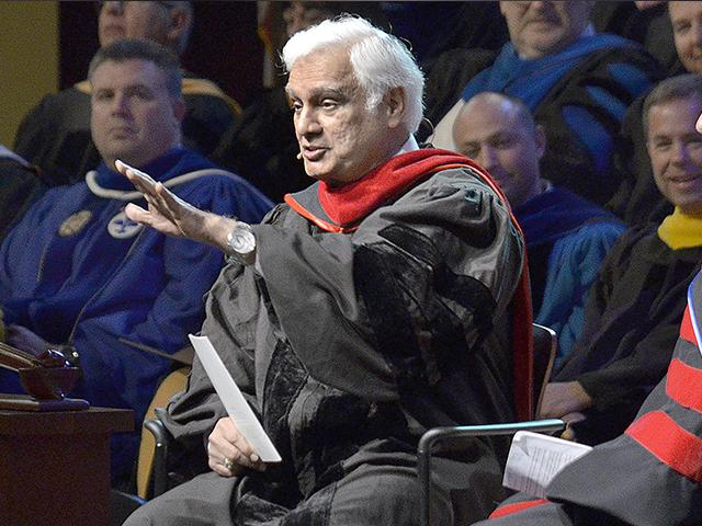 Christian apologist and author Ravi Zacharias, left, talks with associate professor Lenny Luchetti during the Society of World Changers induction ceremony, March 30, 2016, at Indiana Wesleyan University (Jeff Morehead/The Chronicle-Tribune via AP)