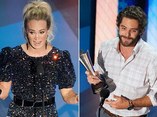 Carrie Underwood, left, and Thomas Rhett accept their entertainer of the year awards during the 55th annual Academy of Country Music Awards at the Grand Ole Opry House on Wednesday, Sept. 16, 2020, in Nashville, Tenn. (AP Photo/Mark Humphrey)
