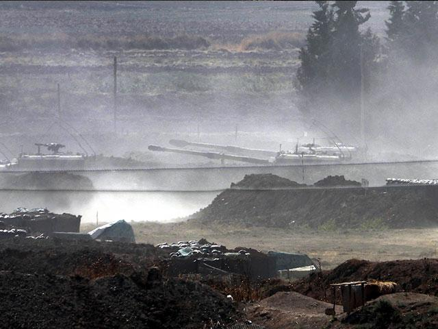 Turkish forces artillery pieces are driven to their new positions near the border with Syria in Sanliurfa province, Turkey to target US-backed Kurdish-led forces in Syria. (DHA via AP)