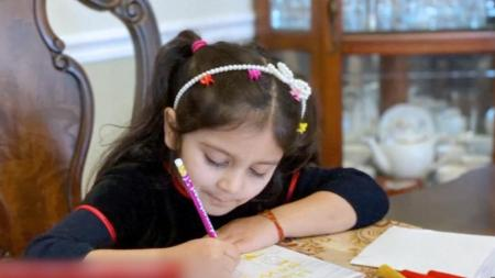 5-Year-Old Girl in New York Handcrafts 200 New Year's Cards for Nursing Home Residents