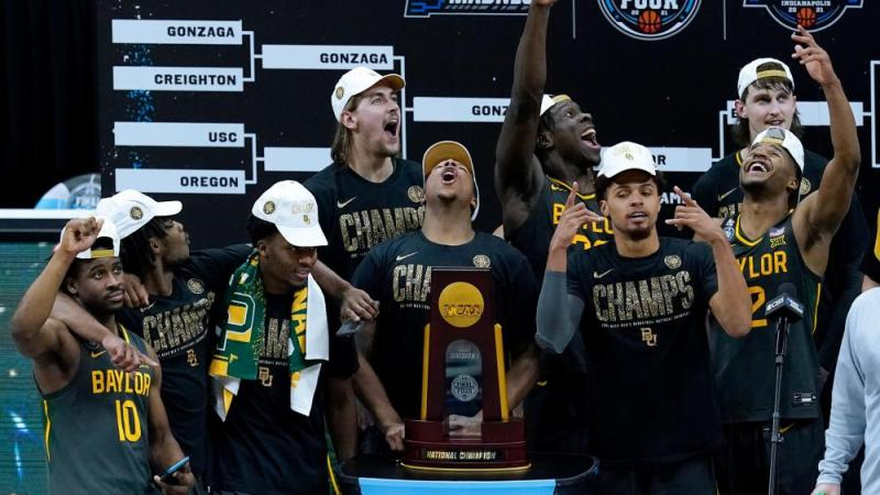 Baylor players celebrate with the trophy after the championship game against Gonzaga in the men's Final Four NCAA college basketball tournament, Monday, April 5, 2021, at Lucas Oil Stadium in Indianapolis. Baylor won 86-70. (AP Photo/Darron Cummings)