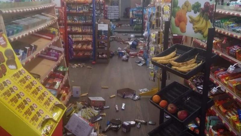 Various items litter the floor in Sparta, N.C. store after an earthquake shook much of North Carolina early Sunday, Aug. 9, 2020. (Michael Hull via AP)