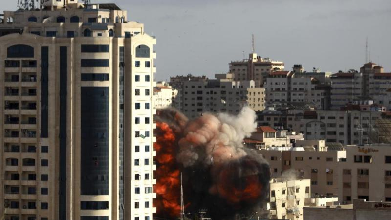 An Israeli air strike hits a building in Gaza City, Monday, May 17, 2021. (AP Photo/Hatem Moussa)