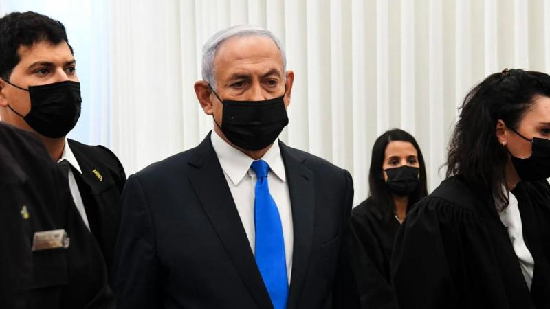 Israeli Prime Minister Benjamin Netanyahu stands at a hearing at the district court in Jerusalem, Monday, Feb. 8, 2021. (AP Photo/Reuven Castro, Pool)