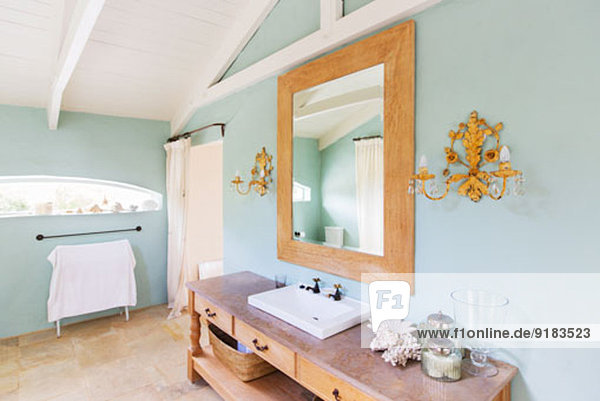sink and mirror in rustic bathroom