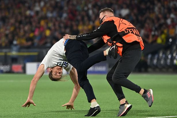 Manchester United's Champions League Clash With Young Boys Was Briefly Disrupted By A Pitch Invader