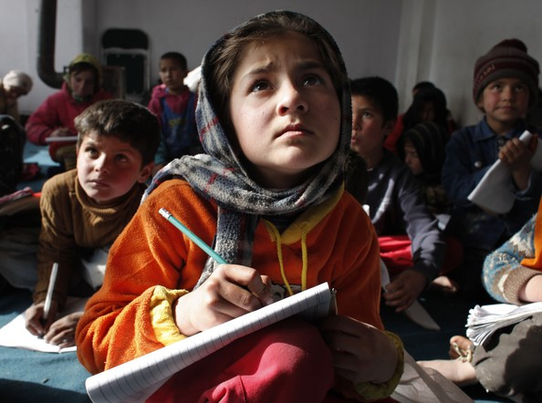 Mariam, 8, copies the blackboard during class at the Aschiana school February 28, 2008 in Kabul, Afghanistan.