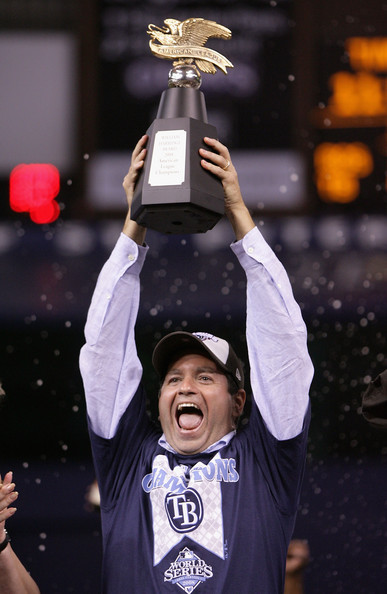 Principal owner of the Tampa Bay Devil Rays, Stuart Sternberg celebrates with the American League Champion's trophy after defeating the Boston Red Sox in game seven of the American League Championship Series during the 2008 MLB playoffs on October 19, 2008 at Tropicana Field in St Petersburg, Florida.  The Rays defeated the Red Sox 3-1 to win the series 4-3.