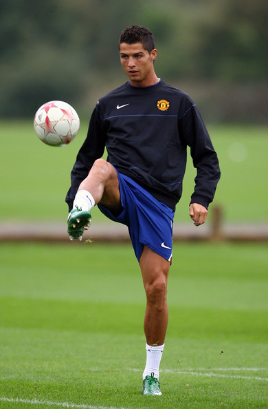 Cristiano Ronaldo Cristiano Ronaldo of Manchester United juggles with the ball during a training session held at the Carrington Training Complex on September 16, 2008 in Carrington, England.  (Photo by Alex Livesey/Getty Images) *** Local Caption *** Cristiano Ronaldo