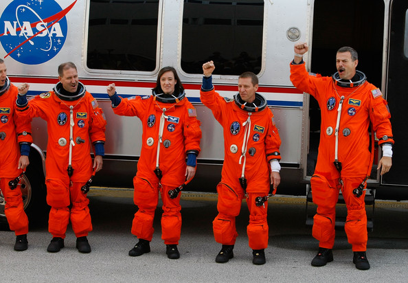 Space Shuttle Atlantis STS-125 astronauts, (L-R) mission specialists John Grunsfeld, mission specialists Megan McArthur, pilot Greg Johnson and commander Scott Altman wave as they prepare to head to the launch pad for a 2:01pm launch today at Kennedy Space Center on May 11, 2009 in Cape Canaveral, Florida. The Space Shuttle Atlantis is scheduled to liftoff on a mission to service the Hubble telescope.  (Photo by Joe Raedle/Getty Images) *** Local Caption *** Scott Altman;Megan McArthur;Greg Johnson;John Grunsfeld