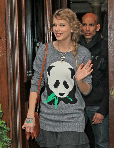 Taylor Swift Taylor Swift leaves her hotel wearing a panda print sweater.