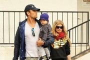 "Couple Fergie and Josh Duhamel take their son Axl out for breakfast in Brentwood, California on December 20, 2014. Fergie recently expressed an interest in expanding their family saying ""We definitely want another one,"" Fergie admitted. ""But there are no plans anytime in the near future."""
