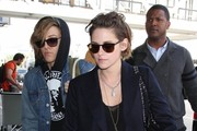 'Twilight' actress Kristen Stewart departing on a flight at LAX airport in Los Angeles, California with her Alicia Cargile on February 4, 2015.