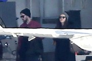 "Singer Justin Timberlake and his pregnant wife Jessica Biel look to be spending New Years outside of Los Angeles, as they're seen boarding a private jet with family on December 28, 2014 in Los Angeles, California. Justin spoiled Jessica this Christmas by doing the holiday baking- he posted a picture of himself draped over a stand mixer and captioned it, ""Just so y'all know who was doing the baking today… Yeah, buddy! Your boy got it in! Merry Christmas and stuff…"""