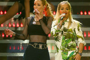 Rapper Iggy Azalea (L) and singer Rita Ora perform onstage during 103.5 KISS FM's Jingle Ball 2014 at Allstate Arena on December 18, 2014 in Chicago, Illinois.