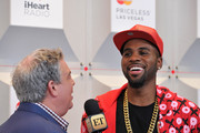 Radio personality Elvis Duran (L) and recording artist Jason Derulo attend the 2014 iHeartRadio Music Festival at the MGM Grand Garden Arena on September 19, 2014 in Las Vegas, Nevada.