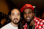 Recording artists Steve Aoki (L) and Jason Derulo attend the 2014 iHeartRadio Music Festival at the MGM Grand Garden Arena on September 19, 2014 in Las Vegas, Nevada.