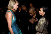(L-R) Recording Artists Taylor Swift, Kanye West and tv personality Kim Kardashian attend The 57th Annual GRAMMY Awards at the STAPLES Center on February 8, 2015 in Los Angeles, California.