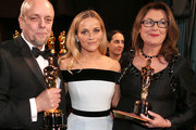 (L-R) Mark Coulier, winner of the Best Makeup & Hairstyling Award for 'The Grand Budapest Hotel', actress Reese Witherspoon, and Frances Hannon, winner of the Best Makeup & Hairstyling Award for 'The Grand Budapest Hotel' attend the 87th Annual Academy Awards at Dolby Theatre on February 22, 2015 in Hollywood, California.
