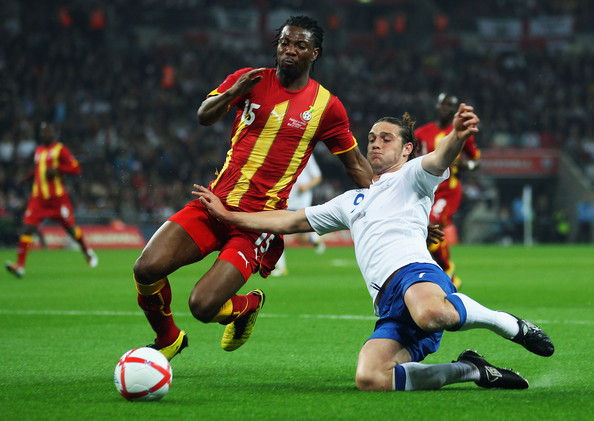 Andy Carroll Isaac Vorsah (L) of Ghana challenges Andy Carroll of England during the international friendly match between England and Ghana at Wembley Stadium on March 29, 2011 in London, England.