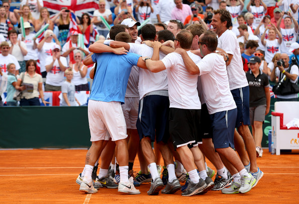 Andy Murray Andy Murray of Great Britain is congratulated by team mates after winning against Ivan Dodig of Croatia during day three of the Davis Cup World Group play-off tie between Croatia and Great Britain at Stadion Stella Maris on September 15, 2013 in Umag, Croatia.