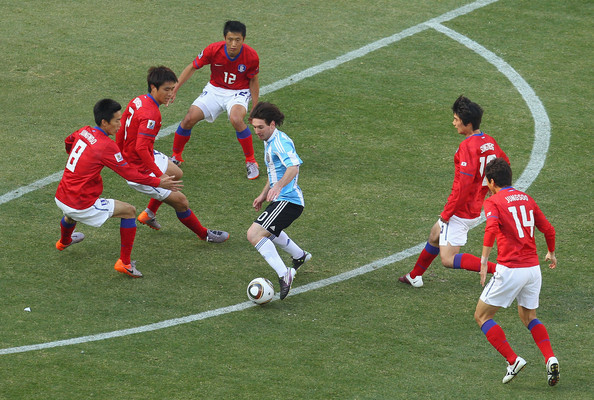 Lionel Messi of Argentina takes on the South Korea defence during  the 2010 FIFA World Cup South Africa Group B match between Argentina and  South Korea at Soccer City Stadium on June 17, 2010 in Johannesburg,  South Africa.