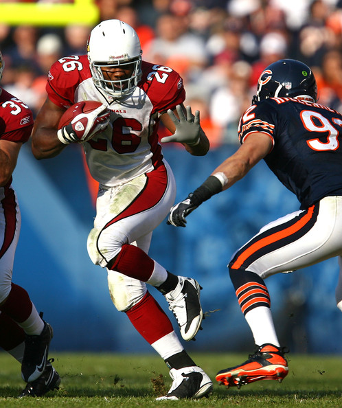 Beanie Wells Beanie Wells #26 of the Arizona Cardinals runs against Hunter Hillenmeyer #92 of the Chicago Bears at Soldier Field on November 8, 2009 in Chicago, Illinois. The Cardinals defeated the Bears 41-21.