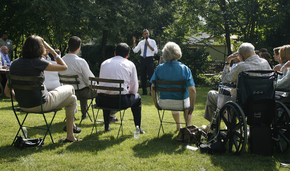 Barack Obama U.S. President Barack Obama (C) visits with neighbors in the backyard of the Weithman family August 18, 2010 in Columbus, Ohio. He was in town to discuss the economy and take questions.