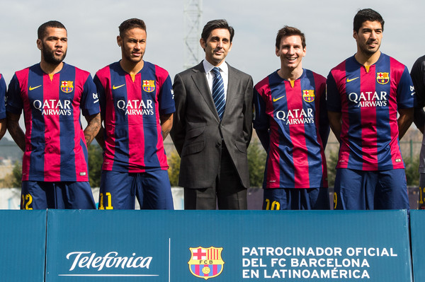 (L-R)  Dani Alves, Neymar, Telefonica CEO Jose Maria Alvarez Pallete, Lionel Messi and Luis Suarez of FC Barcelona pose during the presentation of a partnership agreement at Ciudad Deportiva de Sant Joan Despi on February 18, 2015 in Barcelona, Spain.