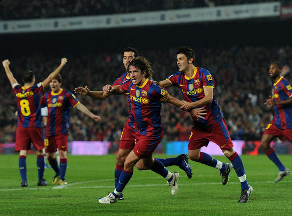 Carles Puyol Carles Puyol (C) of Barcelona celebrates scoring his sides second goal with his teammates Sergio Busquets (L) and David Villa (R) during the La Liga match between Barcelona and Valencia at the Camp Nou stadium on October 16, 2010 in Barcelona, Spain. Barcelona won the match 2-1.