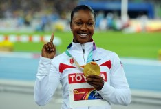 Carmelita Jeter Gold medalist Carmelita Jeter of United States celebrates on the podium with her medal for the women's 100 metres during day four of the 13th IAAF World Athletics Championships at the Daegu Stadium on August 30, 2011 in Daegu, South Korea.