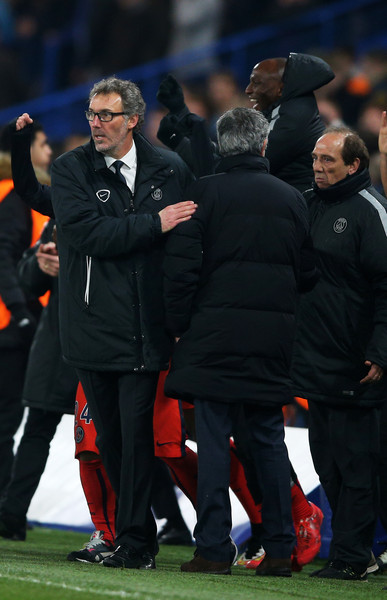 Laurent Blanc the head coach of PSG shakes hands with Jose Mourinho the manager of Chelsea following his team's victory during the UEFA Champions League Round of 16, second leg match between Chelsea and Paris Saint-Germain at Stamford Bridge on March 11, 2015 in London, England.