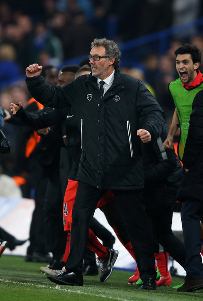 Laurent Blanc the head coach of PSG celebrates following his team's victory in extra time during the UEFA Champions League Round of 16, second leg match between Chelsea and Paris Saint-Germain at Stamford Bridge on March 11, 2015 in London, England.
