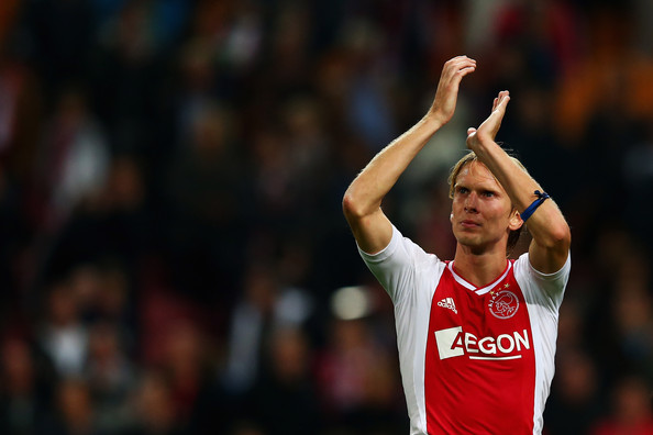 Christian Poulsen Christian Poulsen of Ajax celebrates victory after the Eredivisie match between Ajax Amsterdam and FC Twente at Amsterdam Arena on September 29, 2012 in Amsterdam, Netherlands.