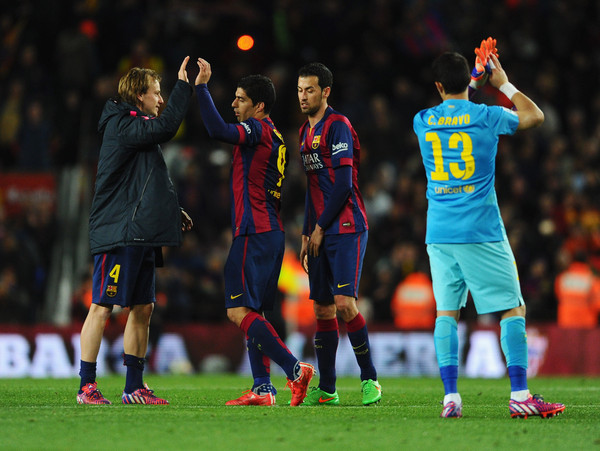 (L-R) Ivan Rakitic, Luis Suarez, Sergio Busquets and Claudio Bravo of Barcelona celebrate victory after the La Liga match between FC Barcelona and Real Madrid CF at Camp Nou on March 22, 2015 in Barcelona, Spain.
